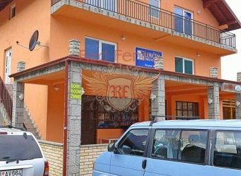 Mini hotel with an area of 350 sqm is located on a plot of 300 sqm.