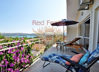 House for sale with stunning views of the Bay and mountains in Tivat, Montenegro.