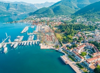 New residential building 150 meters from the sea in the center of Tivat for sale .