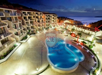 Luxury bright apartment fore sale with panoramic views of the mountains and the town of Przno, Budva riviera, Montenegro, in a new house with a swimming pool.