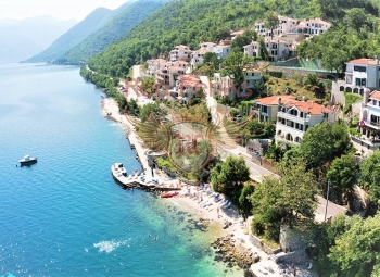 Apartments and villas in a new complex on the beachfront are for sale in Boka bay.