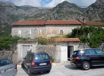 For sale an old, 500-year-old stone house with a view of Kotor Bay and the mountains.