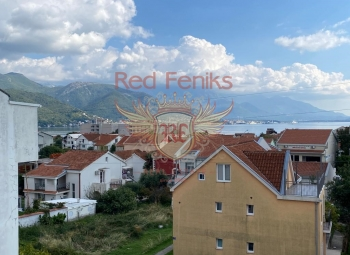 For sale an apartment with two bedrooms, a living room, a separate kitchen and a 65 m2 balcony in the village of Biela.