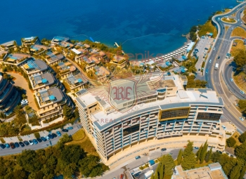 For sale new furnished 2 bedroom apartment with 2 bedrooms with panoramic sea view , big terrace and high seiling! Luxury hotel complex in the front line of Budva Riviera! The total area of 95m2.