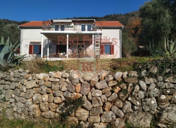Spacious two-level house with a spacious plot in the village of Kavach is for sale.