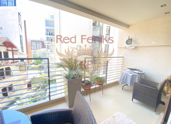 For sale two bedroom apartment in the center only 150 meters from the sea .