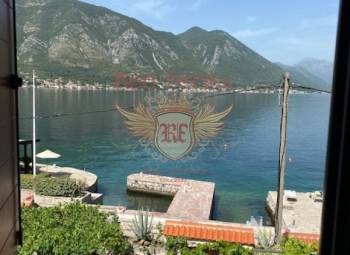 A modern three-storey townhouse for sale on the very shore of the Boka Kotorska Bay in the town of Dobrota.