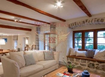 One of a kind, professionally designed and updated old stone character property with terraced outdoor living areas and two off-street parking spaces.
