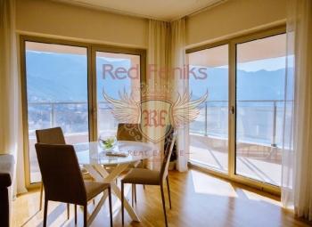 Wohnung zum Verkauf mit 3 Schlafzimmern und einem Wohnzimmer in der Nähe des Meeres mit Panoramablick auf das Meer, die Berge und die Stadt Budva und Becici, Gesamtfläche von 119 m2.