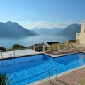 SATILDI ! Spacious apartment with spectacular view over the Kotor Bay located in new residential development with outdoor swimming pool.