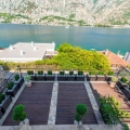 For sale New modern villa in Muo, Kotor located just 30 m from the sea with an area of 510 m2, on three levels and attic.