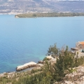 Urbanized plot for sale on Lustica, with an area of 1126 square meters on the first coastline in the Gulf of Tivat, 300 meters from Djurashevichi, allowed the construction of 2 villas with a total area of 337 square meters.