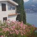 For sale a spacious seaview apartment with one bedroom area of 80 square meters is located 3 km from the center of Igalo, Montenegro.