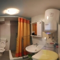 The apartment consists of a spacious room, divided into two parts by a built-in wardrobe.