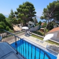 House for sale located in the Green Belt with stunning sea views, surrounded by pine trees.