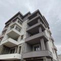 A new residential building with garages is located 1000 meters from the sea.
