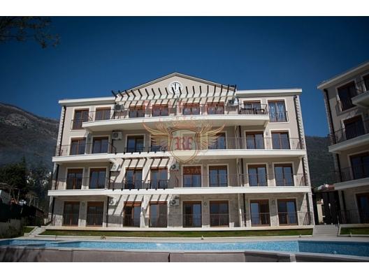 Baosici tatil beldesinin ilk satırında, panoramik körfez manzaralı satılık daire.