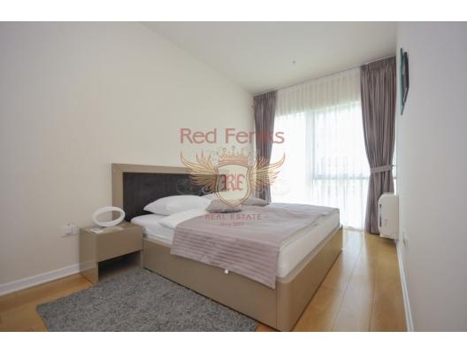 Budva'nın ön cephesinde üç yatak odalı daire 3+1, Karadağ'da garantili kira geliri olan yatırım, Becici da Satılık Konut, Becici da satılık yatırımlık ev