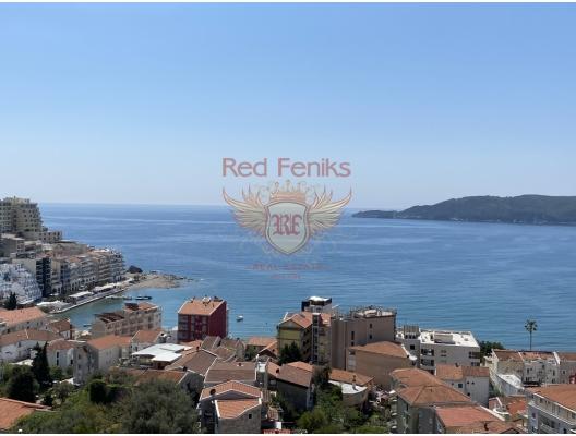 Rafailovici'de yeni binada satılık iki yatak odalı panoramik apartmemt.