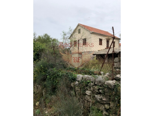 For sale two-storey house with an area of 120 sq m + panoramic terrace of 14 sq m on a plot of 700 sq m with two auxiliary objects of 24 sq m for reconstruction in Djurasevici, Lustica, Montenegro.