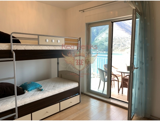 Sea View Two bedroom apartment in Dobrota, investment with a guaranteed rental income, serviced apartments for sale