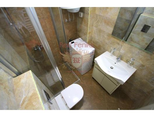 Budva'da iki yatak odalı daire 1+1, Karadağ'da garantili kira geliri olan yatırım, Becici da Satılık Konut, Becici da satılık yatırımlık ev
