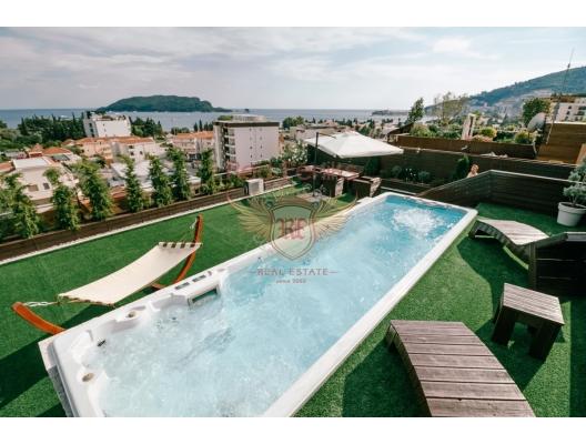 Budva'da 3 yatak odalı ve deniz manzaralı dubleks daire, becici satılık daire, Karadağ da ev fiyatları, Karadağ da ev almak
