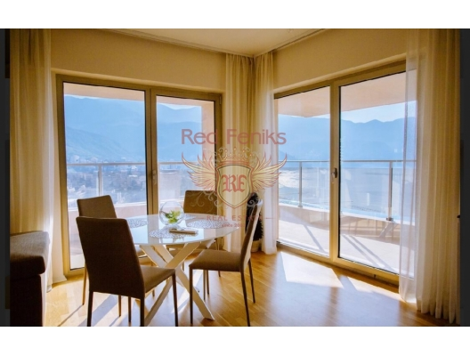 Apartment for sale with 3 bedrooms and a living room near the sea with panoramic views of the sea, mountains and the city of Budva and Becici, total area of 119 m2.