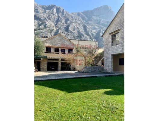 In the center of Dobrota, Kotor bay, Montenegro on a fenced plot of 989 sq m for sale 2 very well maintained houses with spacious terraces.
